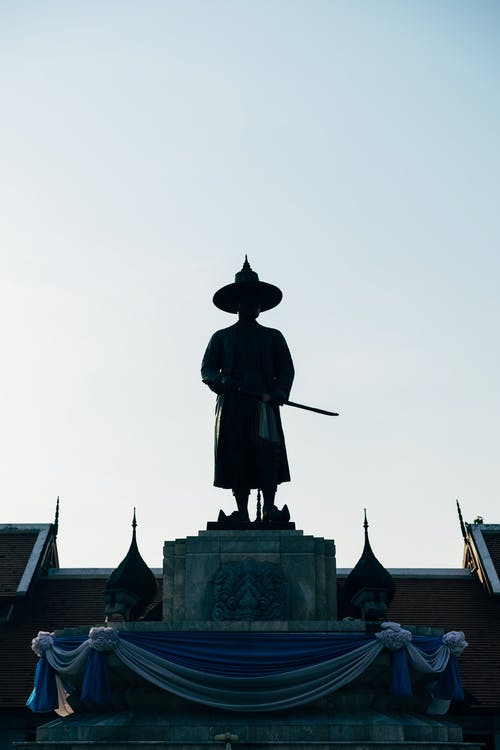 Man in Black Hat Statue
