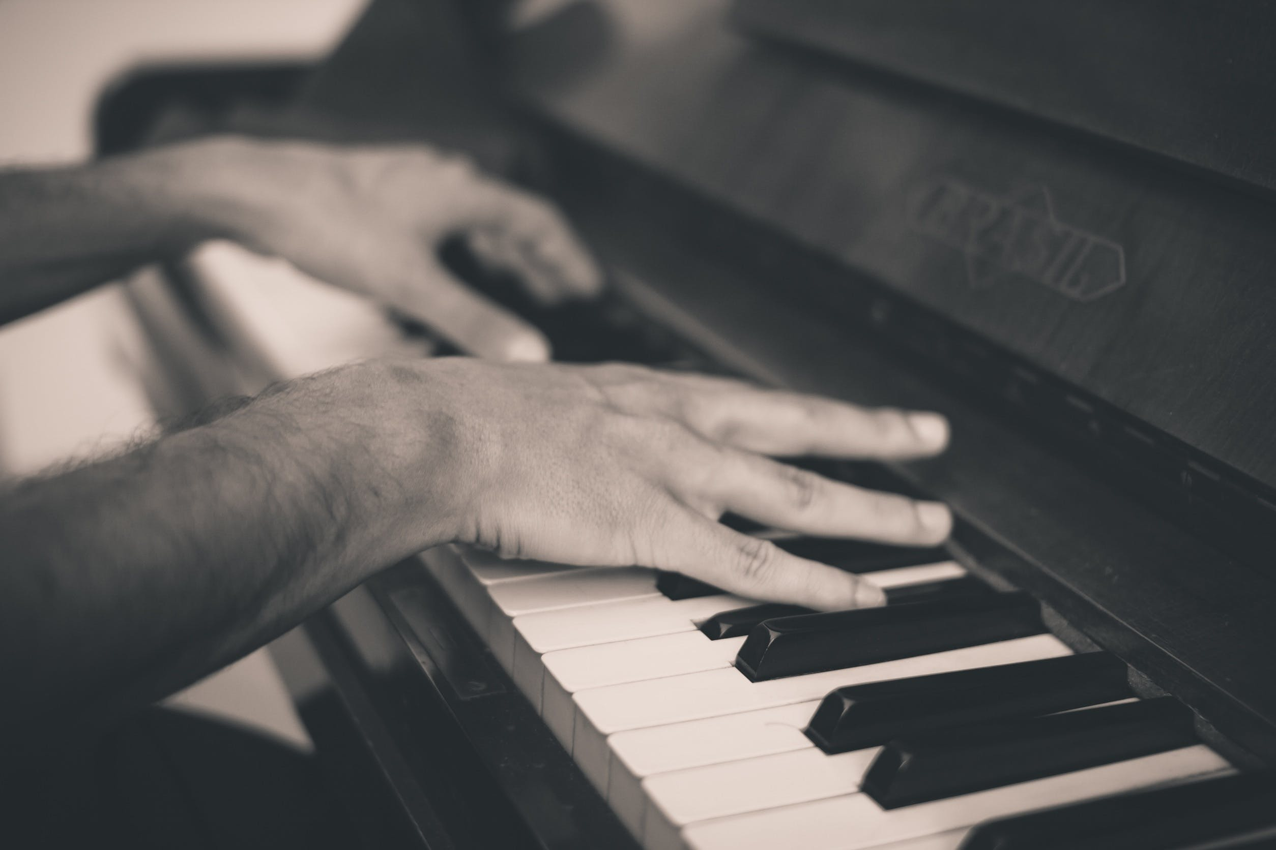 Free stock photo of hands, music, piano, keys