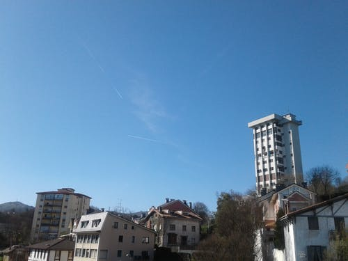 Free stock photo of airplane, apartment building, apartment buildings, beautiful sky