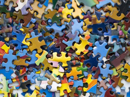 Pink Blue and Yellow Puzzle Piece