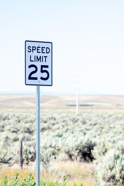 Speed limit sign on road in countryside