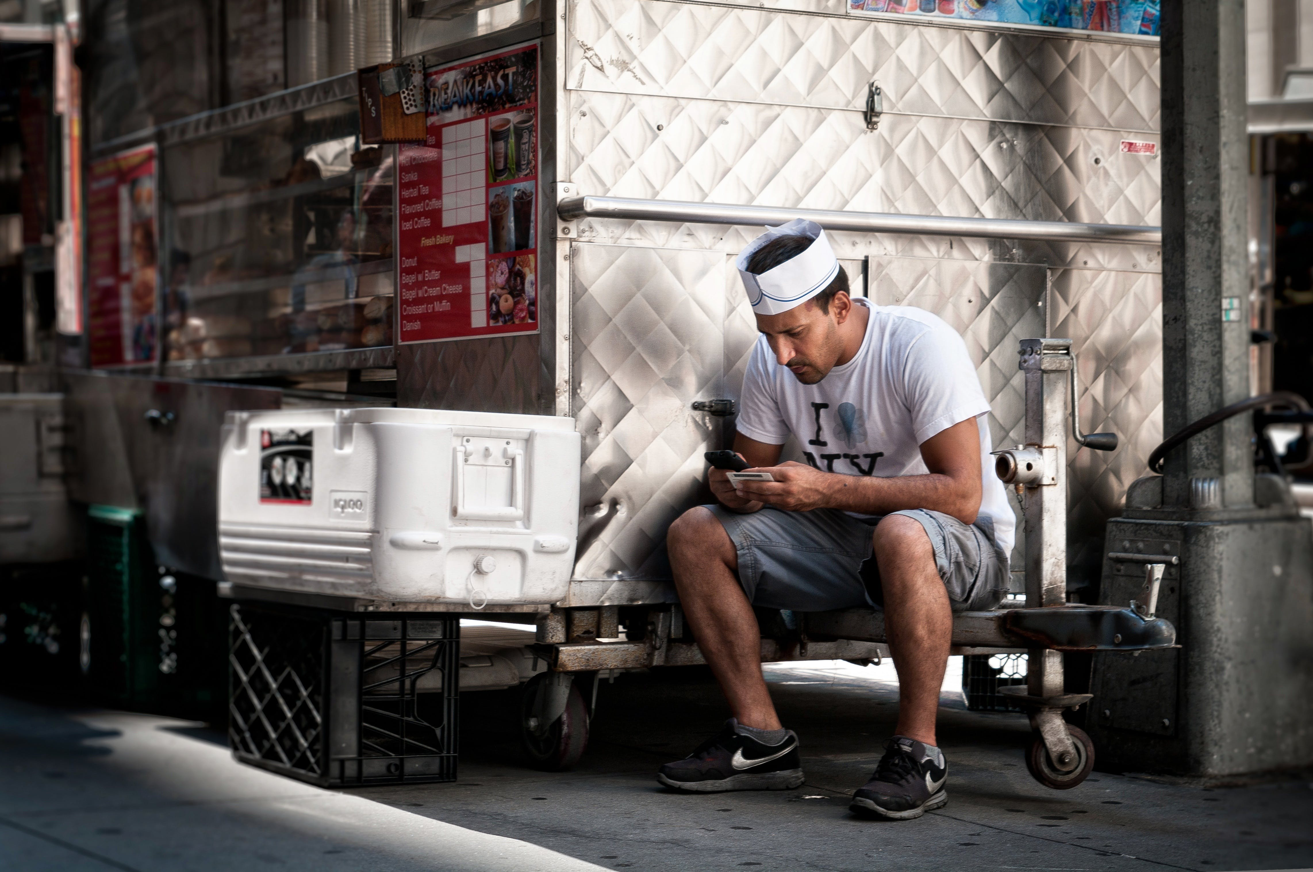 Man Sitting While Using Smartphone
