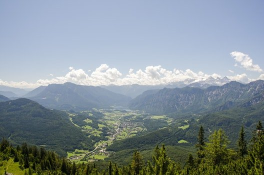 Aerial Photo of Green Mountains Near Cumulus Clouds Under Blue Sky