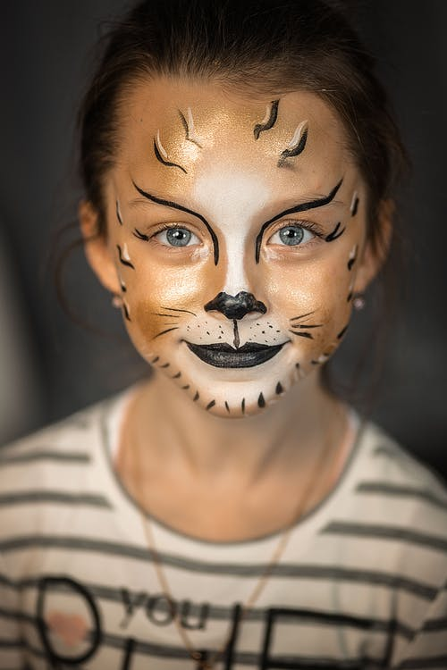 Smiling little girl with painted face