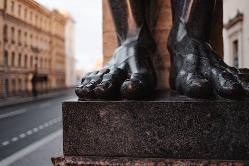 Black Statue on Black Concrete Surface