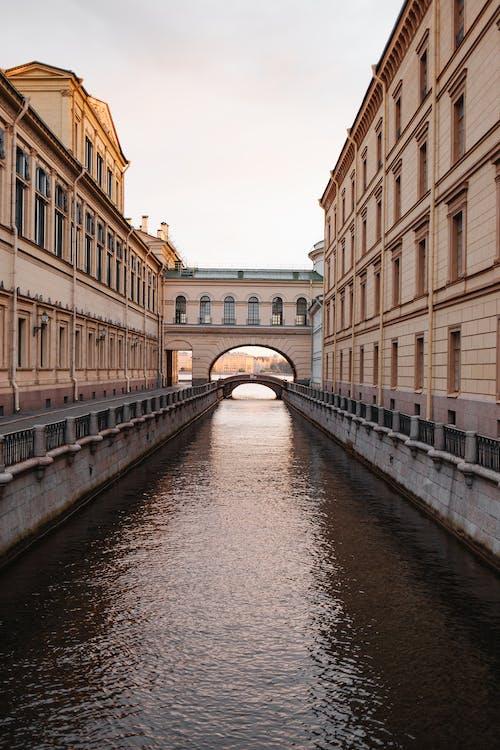 River Between Brown Concrete Building