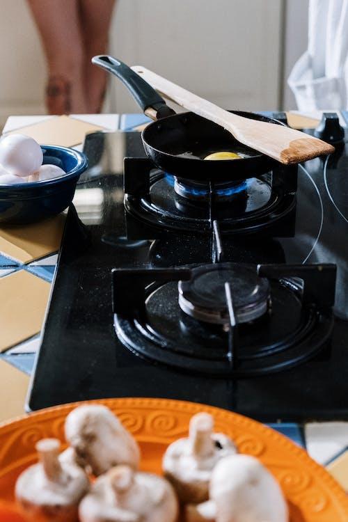 Black Cooking Pot on Black Gas Stove