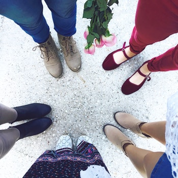 Five Person Wears Footwear at Daytime