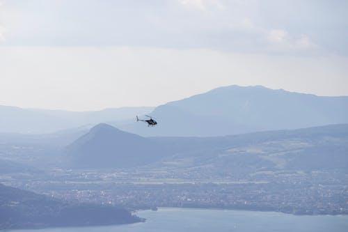 Helicopter flying over coastal river