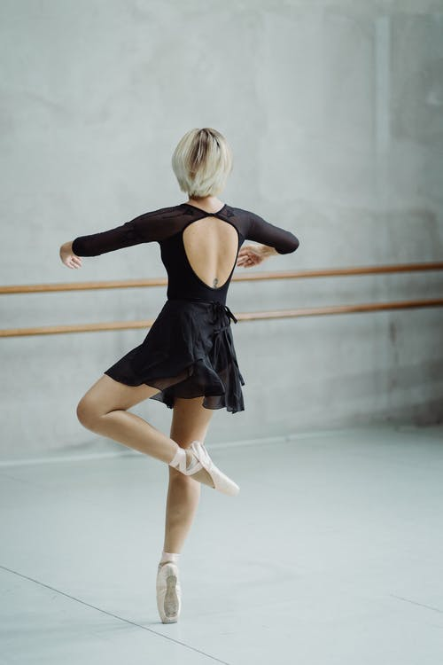 Ballerina standing on tiptoe during dance class