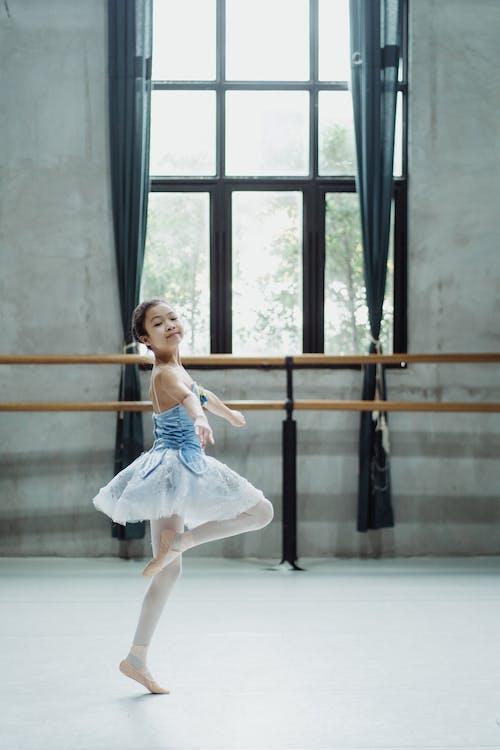 Ballerina in pointe dancing in studio