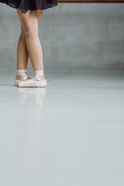 Unrecognizable ballerina in pointe shoes