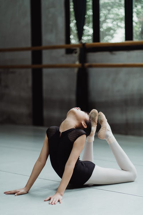 Flexible girl practicing Cobra position in studio