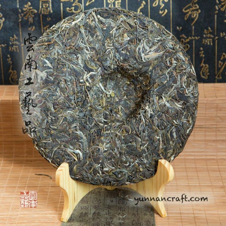 Free stock photo of green pu-erh tea, sheng pu-erh from Yi wu, sheng pu-erh pressed into 357g cake