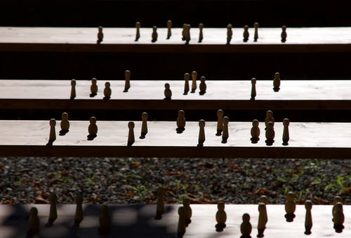 Set of wooden figurines on steps