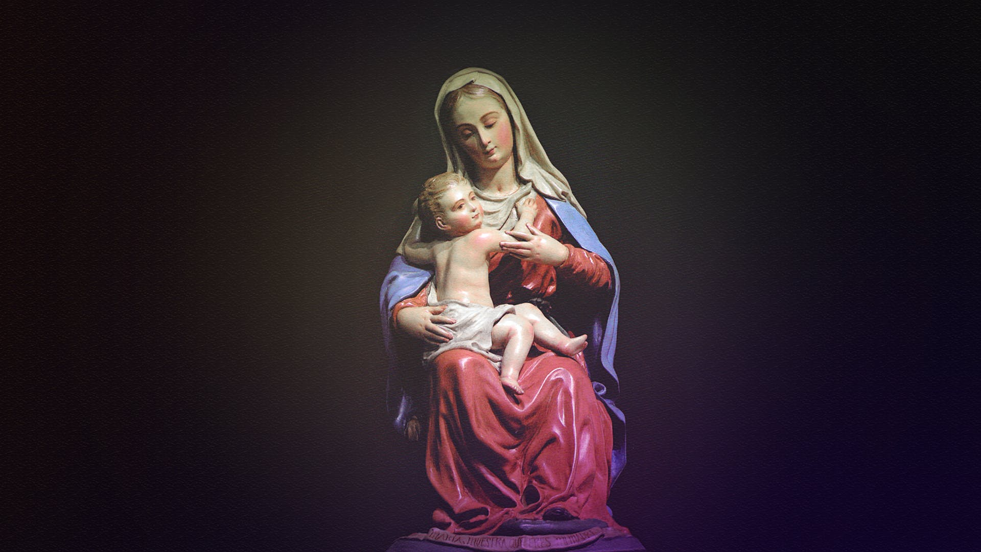 Mother Mary and Christ Figurine on Black Background