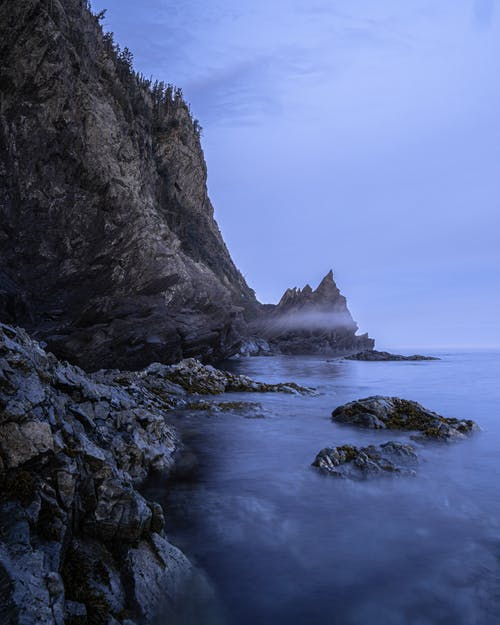 Rough cliff and sea in evening