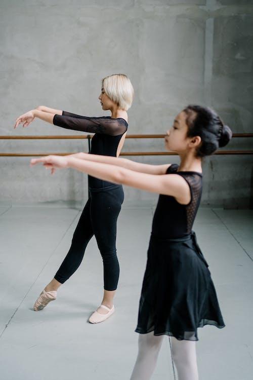 Asian ballerinas practicing ballet dance in studio