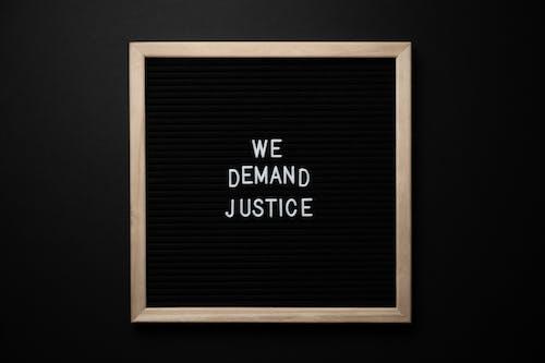 We demand justice inscription in frame