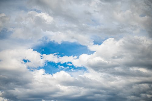 White clouds floating in blue sky on sunny day