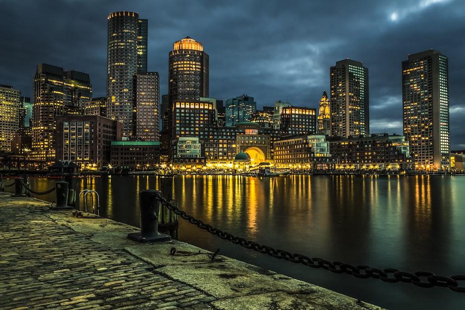 Lighted City Skylines under Deep Blue Sky during Night