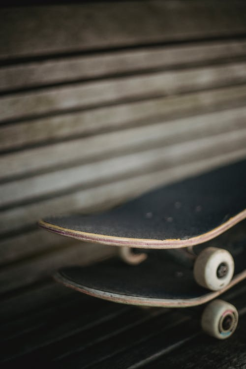 Skateboards placed above each other on bench