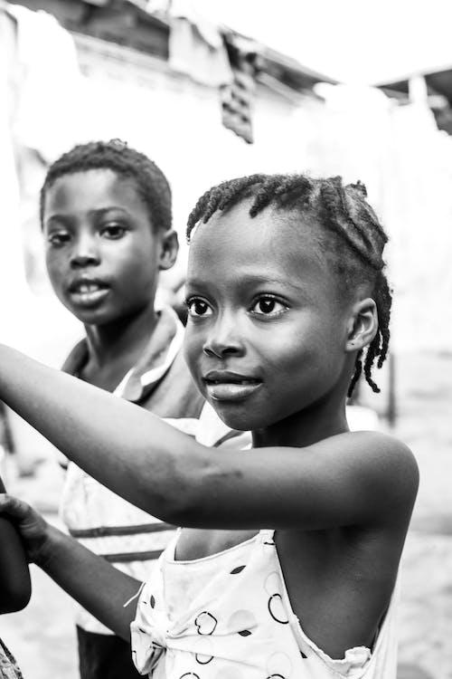 Black kids on street in daylight