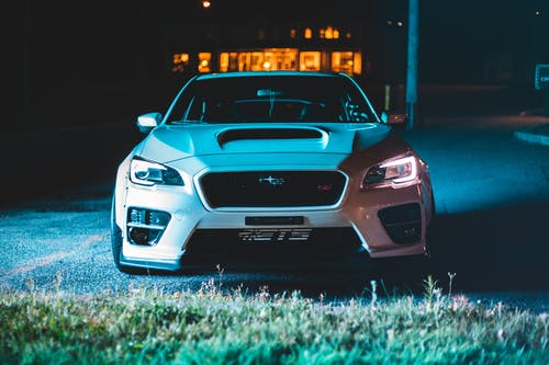 White luxury car with shiny indicators