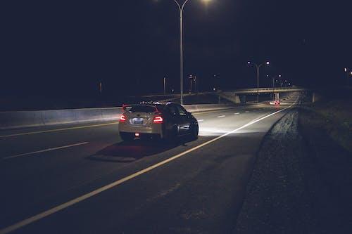 Car driving on asphalt roadway at hight