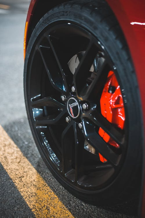Wheel of sport car on parking lot