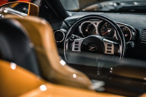 Inside of shiny modern expensive prestige sport automobile with steering wheel and dashboard