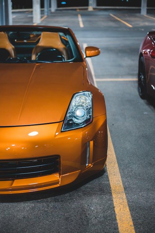 Shiny yellow luxury car at car parking