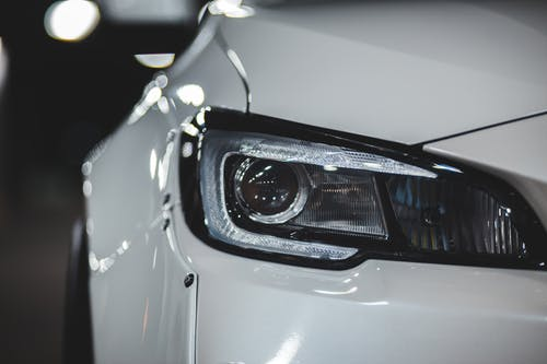 Shiny surface of new car with headlight