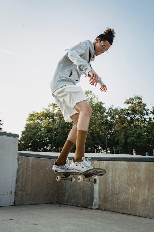 Man Jumping on a Skateboard