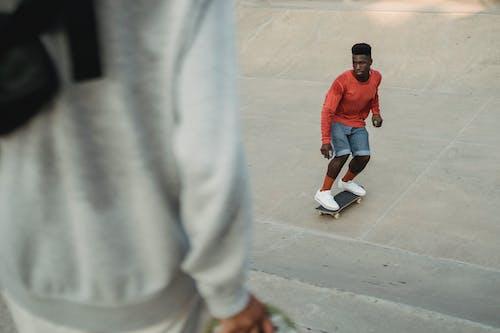 Black man skateboarding in skate park