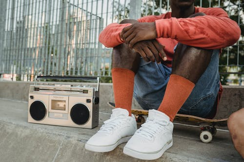 Crop black man with boombox