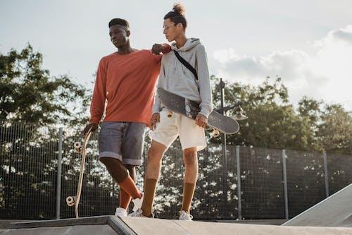 Serious men on ramp in skate park