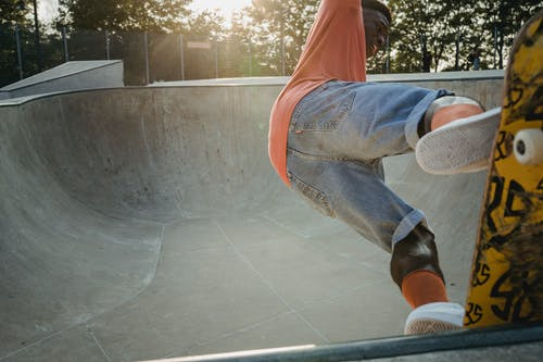 Young man performing trick on skateboard