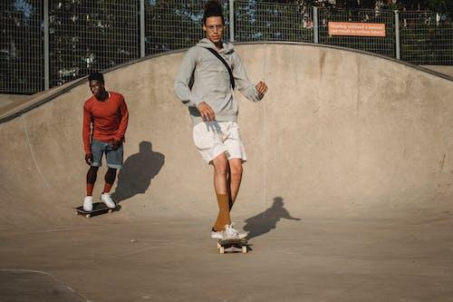 Two Skateboarding Men