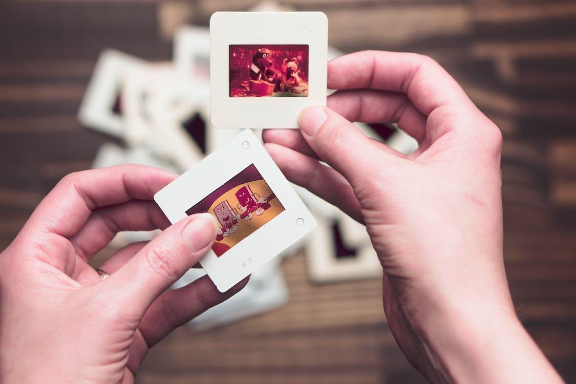 Person Holding Photos