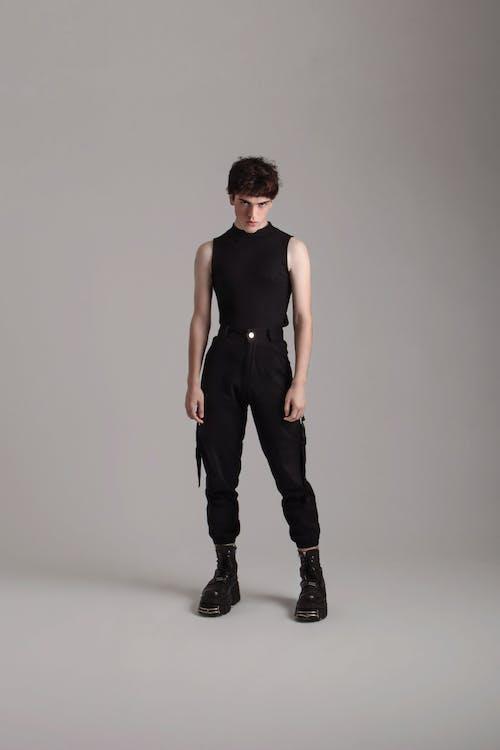 Man in Black Tank Top and Black Pants