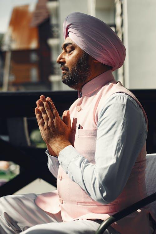 Man in White Dress Shirt and Pink Turban