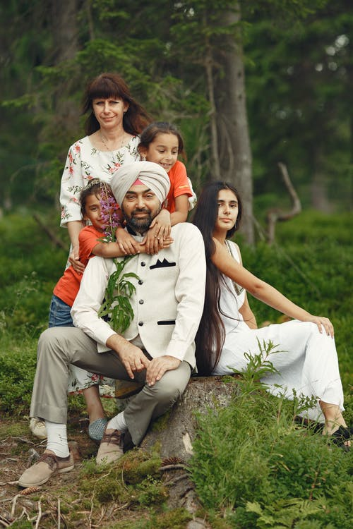 Man Surrounded by his Family