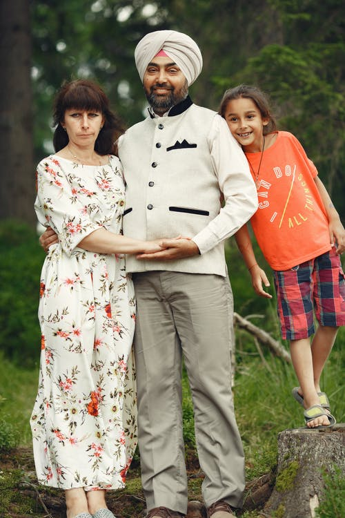 Couple Standing Beside their Child