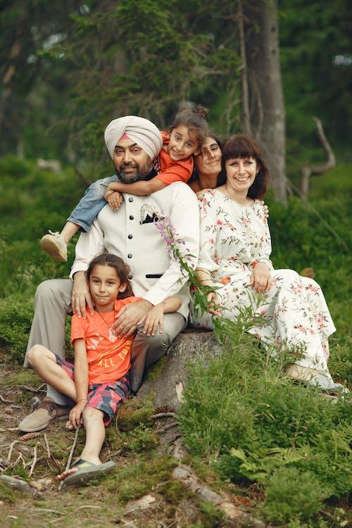 Family Sitting on a Tree Stump