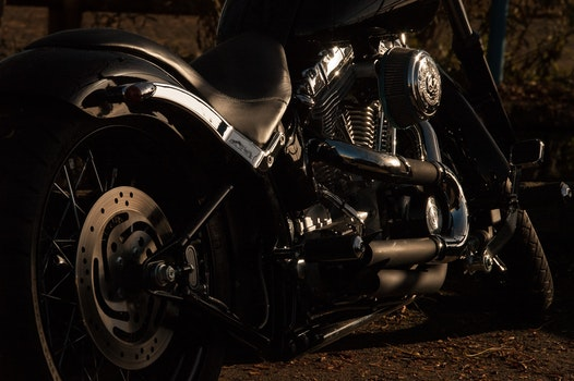 Black and Silver Cruiser Motorcycle on Brown Soil during Night Time