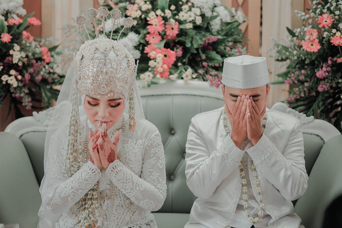 Woman in White Long Sleeve Wedding Dress