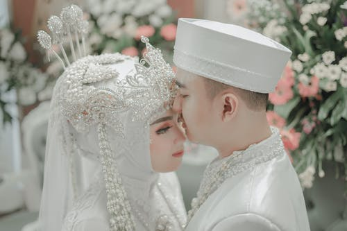 Couple Wearing Wedding Clothes