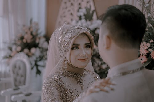 Woman Wearing a Wedding Dress Smiling