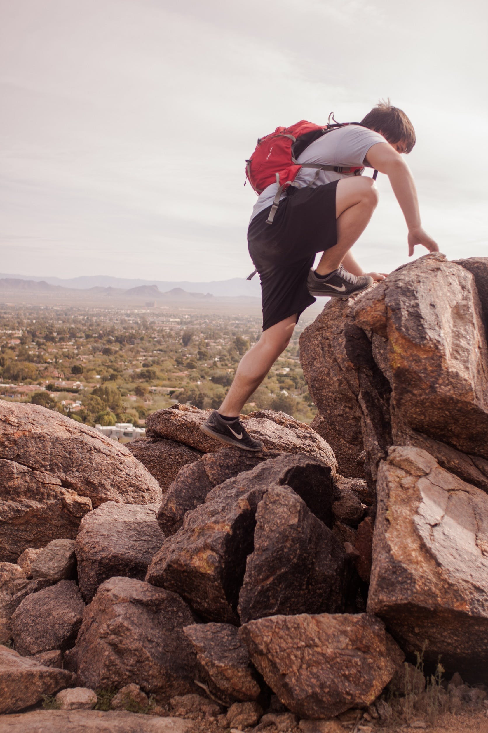 Free stock photo of shorts, people, rocks, hiker